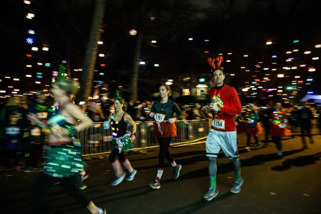 A group of runners makes their last lap at the Running of the Balls in Greensboro NC on December 14 2019 Photo Cred Khadejeh Nikouyeh News & Record